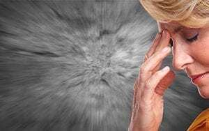 Woman with migraine due to anxiety Nuerofeedback can help